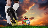 Composite image of football boot kicking flag ball