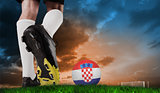 Composite image of football boot kicking croatia ball