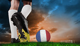 Composite image of football boot kicking france ball