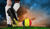 Composite image of football boot kicking germany ball