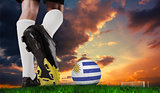 Composite image of football boot kicking uruguay ball