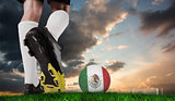 Composite image of football boot kicking mexico ball