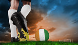 Composite image of football boot kicking ivory coast ball