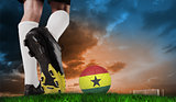 Composite image of football boot kicking ghana ball
