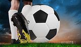 Composite image of football boot kicking huge ball