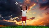 Composite image of goalkeeper in white cheering