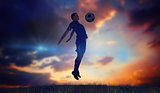 Composite image of football player in blue jumping
