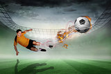 Composite image of football player in orange kicking