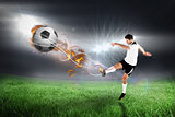 Composite image of football player in white kicking
