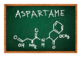 Aspartame chemical formula on school chalkboard