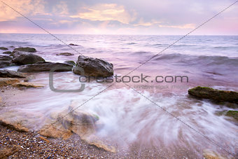Colorful  Sunrise over the Sea and Rocky Coastline