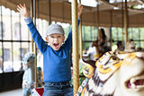 boy at carousel