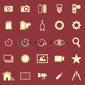 Camera color icons on red background