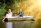 Young just married bride and groom on boat