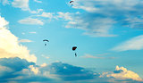 unidentified skydivers, parachutist on blue sky
