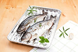 Fish on grilling tray ready for barbecue.