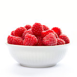 Big Pile of Fresh Raspberries in the Bowl Isolated on Whitу
