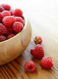 Ripe Red Juicy Raspberries in the Wooden Bowl on Wooden Table