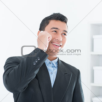 Asian business executive talking on smartphone