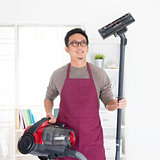 Asian man vacuuming
