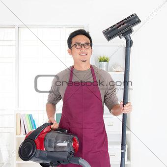 Asian man vacuuming