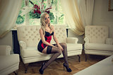 sensul woman sitting on sofa in lingerie