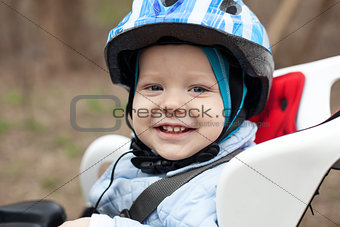 Little boy in bicycle seat