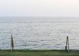 Wooden pier with metal handrails