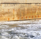Seawater and the old concrete wall
