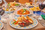 A la carte steak meal on patterned plate