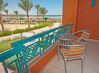 Chairs and table on hotel balcony