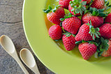 red strawberries on green dish