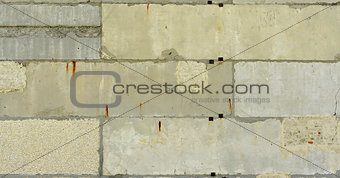 Old, cracked surface of concrete and bricks