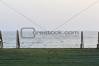 Wooden pier with metal handrails