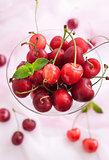 Fresh wet cherry in a glass