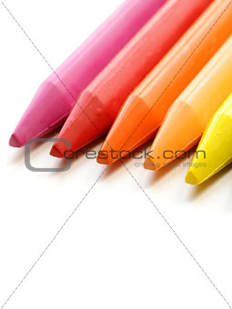multicolored pencil crayons on a white background