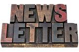 newsletter in grunge wood type