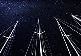 Sailboat mast on starry sky background