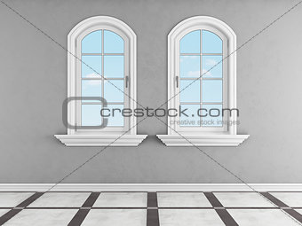 Gray room with two arched windows