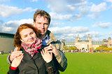 Outdoor happy couple in love, Museum Plein, autumn Amsterdam bac
