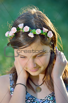 beautiful girl with wreath of flowers