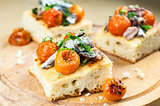 Delicious focaccia with sardines and cherry tomatoes