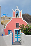 pink church on greek santorini island, greece