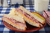 Ham sandwich on a picnic table
