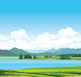 Nature landscape - grass, lake and mountains.