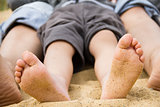children's feet in the sand