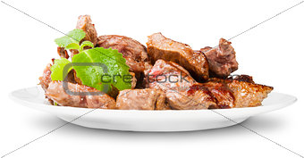 Grilled Meat On A White Plate Rotated Served With Mint Leaf