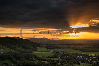 Stunning Summer sunset across countryside landscape