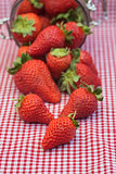 Tasty fresh strawberries in glass storage jar