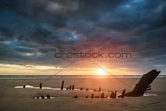 Beautiful dramatic sunset landscape over shipwreck on Rhosilli B